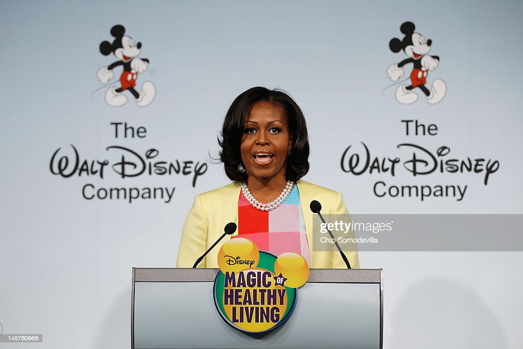 U.S. first lady <a gi-track='captionPersonalityLinkClicked' href=/galleries/search?phrase=Michelle+Obama&family=editorial&specificpeople=2528864 ng-click='$event.stopPropagation()'>Michelle Obama</a> delivers remarks during an event introducing The Walt Disney Company's 'Magic of Healthy Living' program at the Newseum June 5, 2012 in Washington, DC. As part of the new healthy eating initiative, all products advertised on Disney's child-focused television channels, radio stations and Web sites must adhear to a new set of strict nutritional standards. Addionally, Disney-licensed products that meet criteria for limited calories, saturated fat, sodium and sugar can display a logo - Mickey Mouse ears and a check mark - on their packaging.
