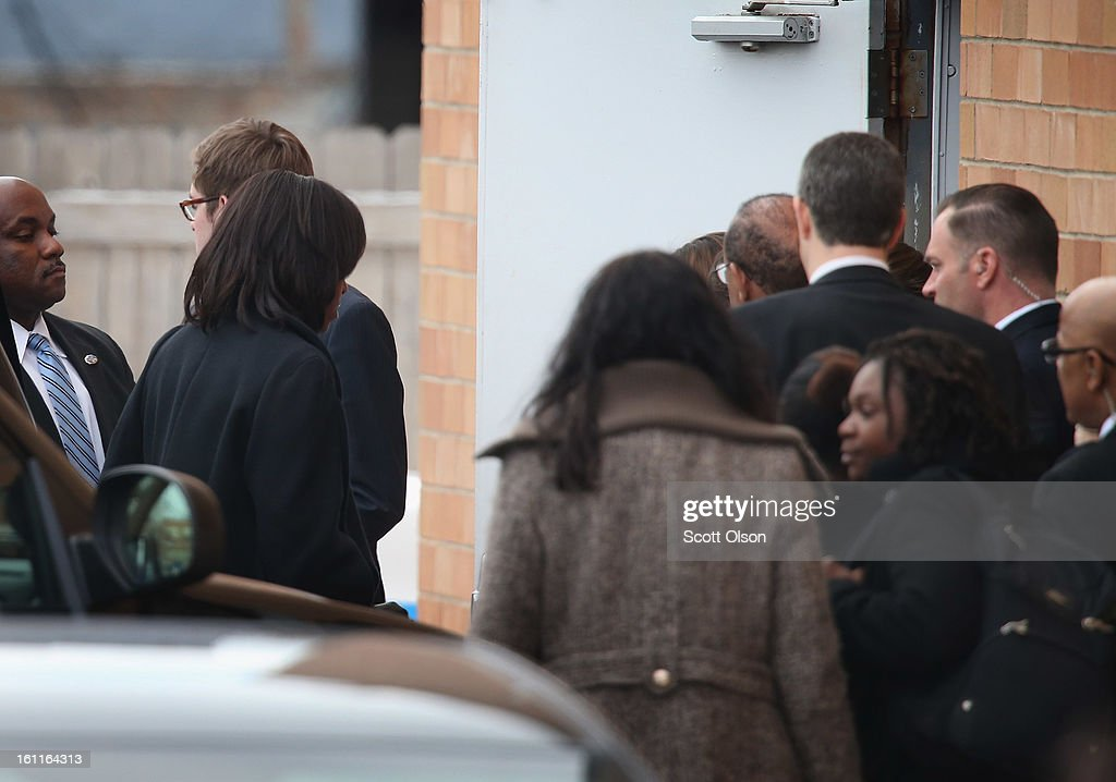 First lady Michelle Obama (L) ducks in a side door after arrivng at the Greater Harvest M.B. Church for the funeral of 15-year-old Hadiya Pendleton on February 9, 2013, in Chicago, Illinois. Hadiya was killed on January 29, when a gunman opened fire on her and some friends while they were standing under a shelter on a warm rainy afternoon in a park about a mile from President Obama's Chicago home. With the first lady were Senior White House Adviser Valerie Jarrett and Secretary of Education Arne Duncan.