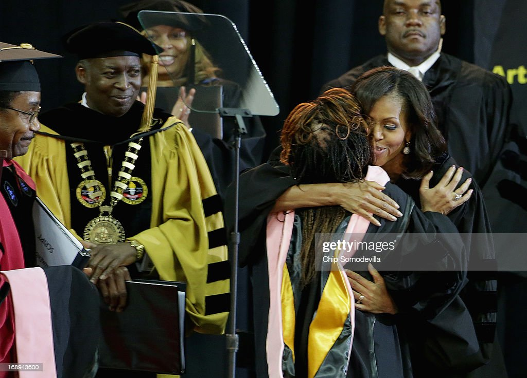 First lady Michelle Obama (R) embraces honorary degree recepient and song writer Valerie Simpson during the Bowie State University graduation ceremony at the Comcast Center on the campus of the University of Maryland May 17, 2013 in College Park, Maryland. Obama received and Honorary Doctor of Laws degree before addressing the 600 graduates of Maryland's oldest historically black university and one of the ten oldest in the country.