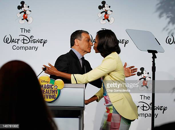 S first lady Michelle Obama embraces The Walt Disney Company Chairman and CEO Robert Iger during an event introducing The Walt Disney Company's...