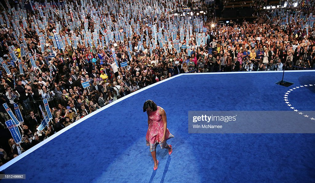First lady <a gi-track='captionPersonalityLinkClicked' href=/galleries/search?phrase=Michelle+Obama&family=editorial&specificpeople=2528864 ng-click='$event.stopPropagation()'>Michelle Obama</a> exits the stage after speaking during day one of the Democratic National Convention at Time Warner Cable Arena on September 4, 2012 in Charlotte, North Carolina. The DNC that will run through September 7, will nominate U.S. President Barack Obama as the Democratic presidential candidate.
