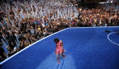 First lady Michelle Obama exits the stage after speaking during day one of the Democratic National Convention at Time Warner Cable Arena on September...