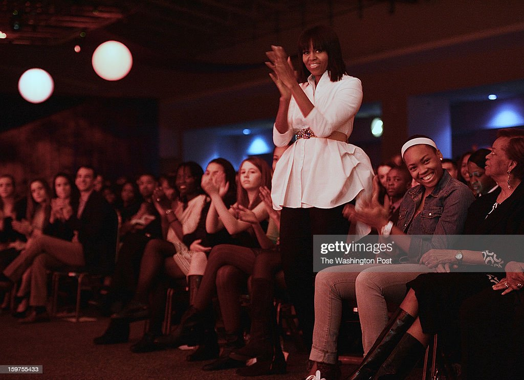 First Lady Michelle Obama gives Usher a standing ovation at the Kids Inaugural celebrationa and concert on January, 19, 2013 in Washington, DC.