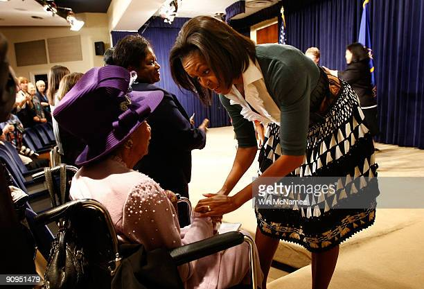 S first lady Michelle Obama greets Dr Dorothy Height following her remarks on health care legislation at the White House complex September 18 2009 in...