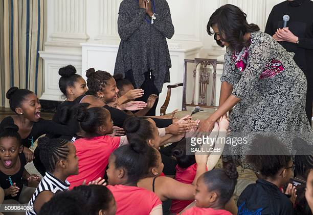 US First Lady Michelle Obama greets local students during a daylong dance workshop to highlight contributions African American women have made to...