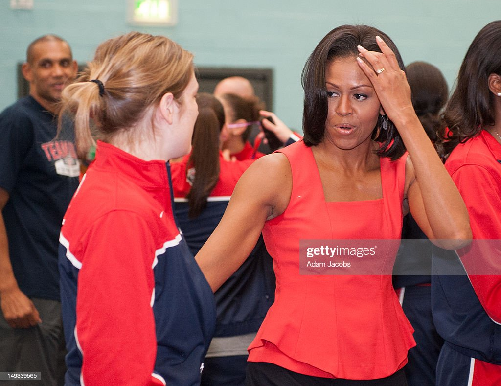 First Lady <a gi-track='captionPersonalityLinkClicked' href=/galleries/search?phrase=Michelle+Obama&family=editorial&specificpeople=2528864 ng-click='$event.stopPropagation()'>Michelle Obama</a> greets members of the the 2012 Team USA at the University of East London on July 27, 2012 in London, England. <a gi-track='captionPersonalityLinkClicked' href=/galleries/search?phrase=Michelle+Obama&family=editorial&specificpeople=2528864 ng-click='$event.stopPropagation()'>Michelle Obama</a> addressed members of the 2012 Team USA as leader of the US Olympics delegation, ahead of opening ceremony for the Olympics.