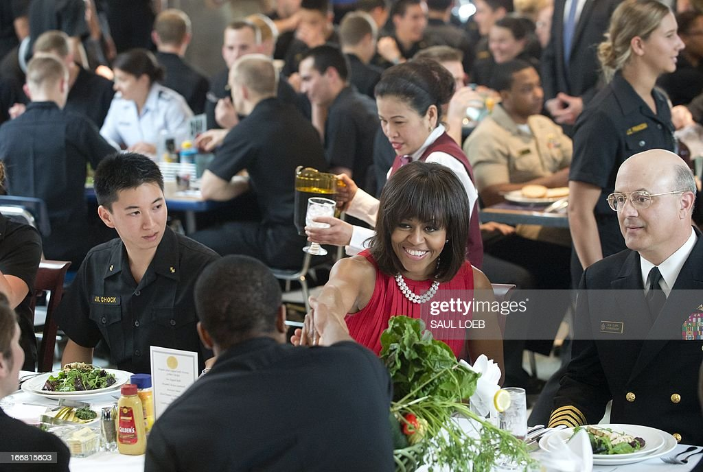 US First Lady Michelle Obama greets Midshipmen during lunch at King Hall at the US Naval Academy in Annapolis, Maryland on April 17, 2013. Obama traveled to Annapolis to join Maryland Governor Martin O'Malley at a bill signing for the Veterans Full Employment Act of 2013, supporting military veterans in licensing, training, education and employment. AFP PHOTO / Saul LOEB