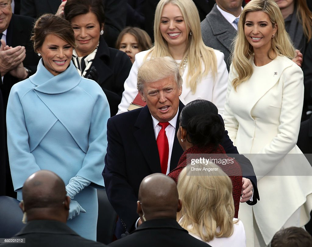 S first lady Michelle Obama greets Presidentelect Donald Trump as Melania Trump Tiffany Trump and Ivanka Trump look on on the West Front of the US...