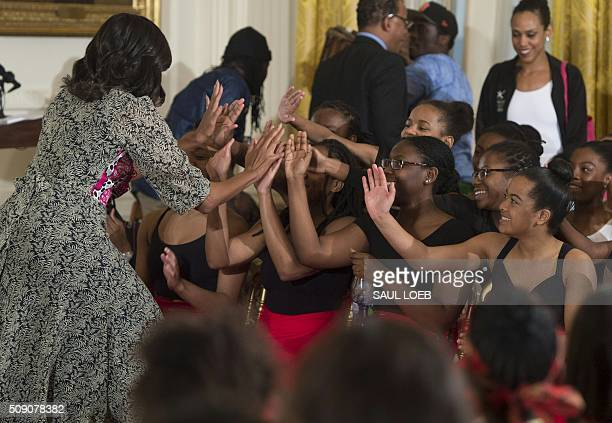 US First Lady Michelle Obama greets students a daylong dance workshop to highlight contributions African American women have made to dance as part of...
