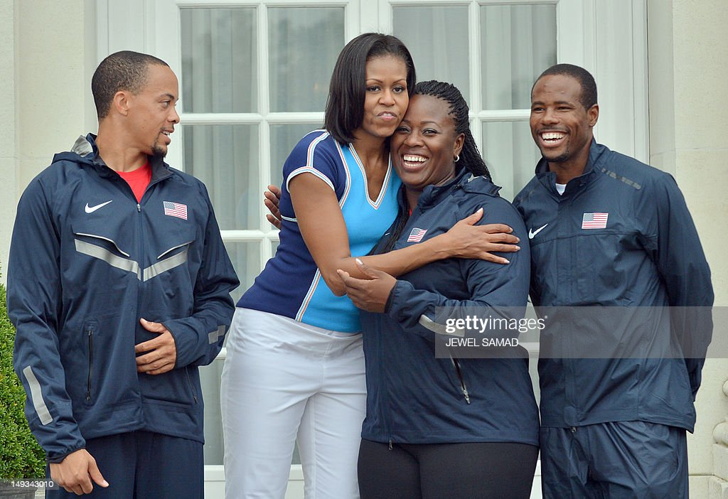 US First Lady Michelle Obama greets US athlete team members during 'Let's Move-London' event at the Winfield House in London on July 27, 2012, hours before the start of the London 2012 Olympic Games.