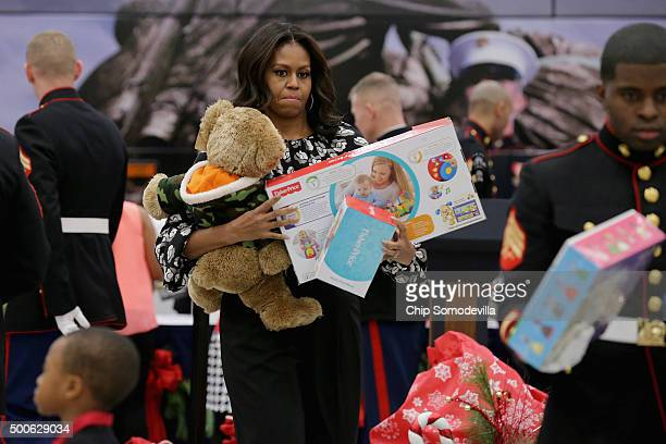 S first lady Michelle Obama helps distribute donations to the US Marine Corps Reserve Toys for Tots Program at Joint Base AnacostiaBolling December 9...
