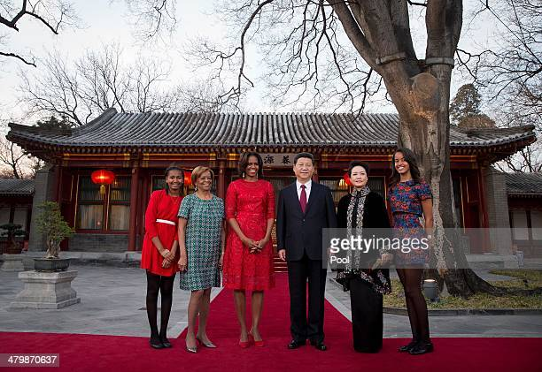 S first lady Michelle Obama her daughters Malia and Sasha and her mother Marian Robinson share a light moment with Chinese President Xi Jinping and...