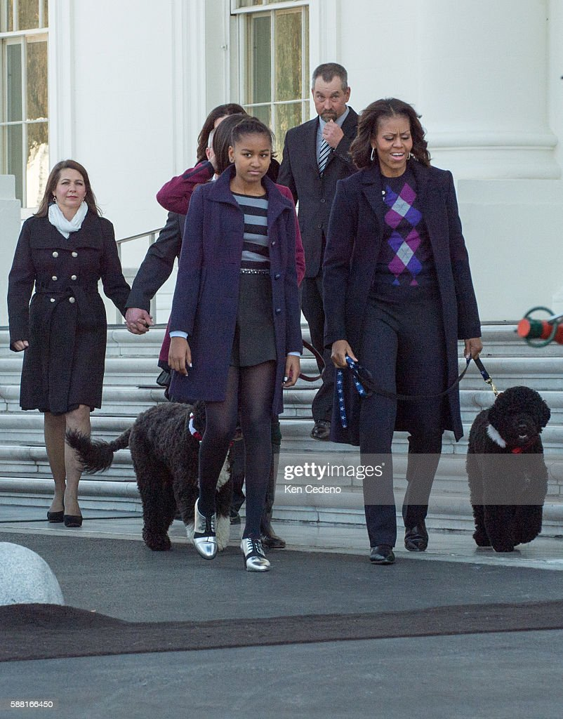 First Lady Michelle Obama her daughters Sasha Obama and Malia Obama the family dogs Bo and Sunny and Christopher Botek and Kyra Yurko of Lehighton...