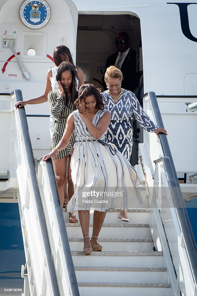 US First Lady <a gi-track='captionPersonalityLinkClicked' href=/galleries/search?phrase=Michelle+Obama&family=editorial&specificpeople=2528864 ng-click='$event.stopPropagation()'>Michelle Obama</a>, her mother Marian Shields Robinson and her daughters <a gi-track='captionPersonalityLinkClicked' href=/galleries/search?phrase=Malia+Obama&family=editorial&specificpeople=2631620 ng-click='$event.stopPropagation()'>Malia Obama</a> and <a gi-track='captionPersonalityLinkClicked' href=/galleries/search?phrase=Sasha+Obama&family=editorial&specificpeople=2631619 ng-click='$event.stopPropagation()'>Sasha Obama</a> arrive at Torrejon Air Force Base on June 29, 2016 in Madrid. The First Lady will deliver a speech on Let Girls Learn to girls and young women, sharing the stories of girls she has met in her prior travels and highlighting new commitments to support Let Girls Learn. Mrs. Obama will encourage the audience to value their own educational opportunities, continue to strive for progress for girls and young women in their country, and take action to help the more than 62 million girls around the world who are out of school, 2016 in Madrid, Spain.