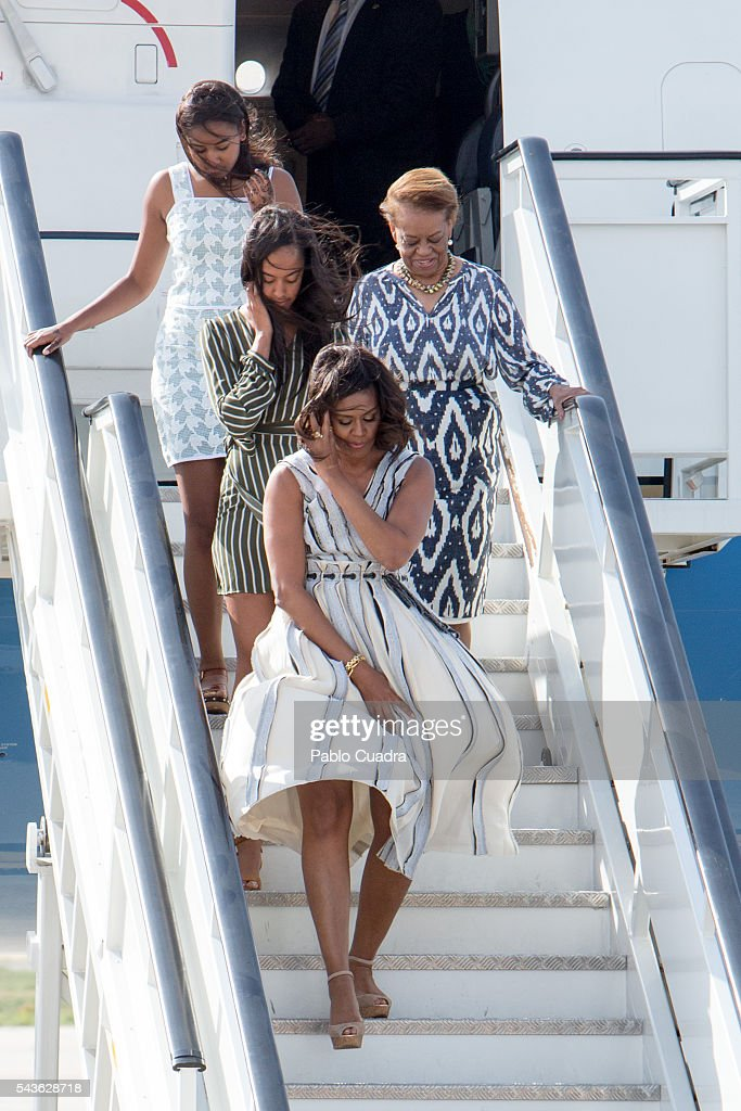 US First Lady <a gi-track='captionPersonalityLinkClicked' href=/galleries/search?phrase=Michelle+Obama&family=editorial&specificpeople=2528864 ng-click='$event.stopPropagation()'>Michelle Obama</a>, her mother Marian Shields Robinson and her daughters <a gi-track='captionPersonalityLinkClicked' href=/galleries/search?phrase=Malia+Obama&family=editorial&specificpeople=2631620 ng-click='$event.stopPropagation()'>Malia Obama</a> and <a gi-track='captionPersonalityLinkClicked' href=/galleries/search?phrase=Sasha+Obama&family=editorial&specificpeople=2631619 ng-click='$event.stopPropagation()'>Sasha Obama</a> arrive at Torrejon Air Force Base on June 29, 2016 in Madrid, Spain. The First Lady will deliver a speech on Let Girls Learn to girls and young women, sharing the stories of girls she has met in her prior travels and highlighting new commitments to support Let Girls Learn. Mrs. Obama will encourage the audience to value their own educational opportunities, continue to strive for progress for girls and young women in their country, and take action to help the more than 62 million girls around the world who are out of school.