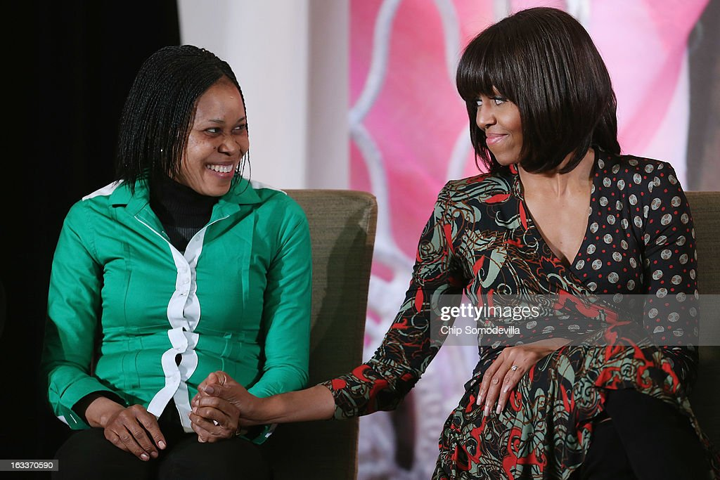 U.S. first lady Michelle Obama (R) holds hands with women's rights advocate Dr. Josephine Obiajulu Odumakin of Nigeria after she received the International Women of Courage award at the State Department March 8, 2013 in Washington, DC. In celebration of the 102nd International Women's Day, the State Department honored nine women from around the world with the International Women of Courage Award, including the 23-year-old Indian woman known only as 'Nirbhaya,' who died from injuries she received after being gang raped by six men last December in Delhi.