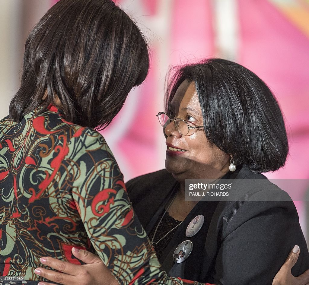 US First Lady Michelle Obama (L) hugs Julieta Castellanos of Honduras after she was presented with the Secretary of State's International Women of Courage Award inside the Dean Acheson Auditorium of the US State Department March 8, 2013 in Washington, Dc. The award annually recognizes women around the globe who have shown exceptional courage and leadership in advocating for women's rights and empowerment, often at great personal risk. Since the inception of this award in 2007, the Department of State has honored 67 women from 45 different countries. AFP Photo/Paul J. Richards