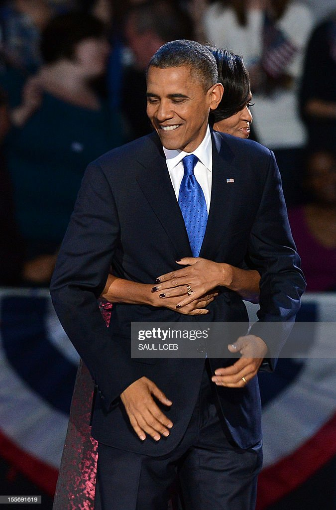 US First Lady Michelle Obama hugs US President Barack Obama as they celebrate on election night November 7, 2012 in Chicago, Illinois. Obama won re-election to a second 4-year term. AFP PHOTO / Saul LOEB