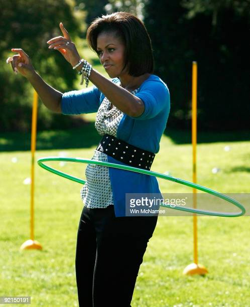 S first lady Michelle Obama hula hoops on the South Lawn of the White House during an event promoting exercise and healthy eating for children...