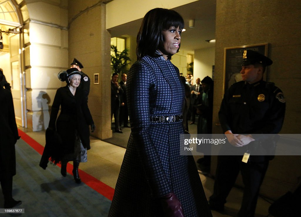 U.S. first lady Michelle Obama is escorted through the corridor to the west door of the U.S. Capitol to begin swearing-in ceremonies on January 21, 2013 in Washington, DC. U.S. President Barack Obama will be ceremonially sworn in for his second term today.