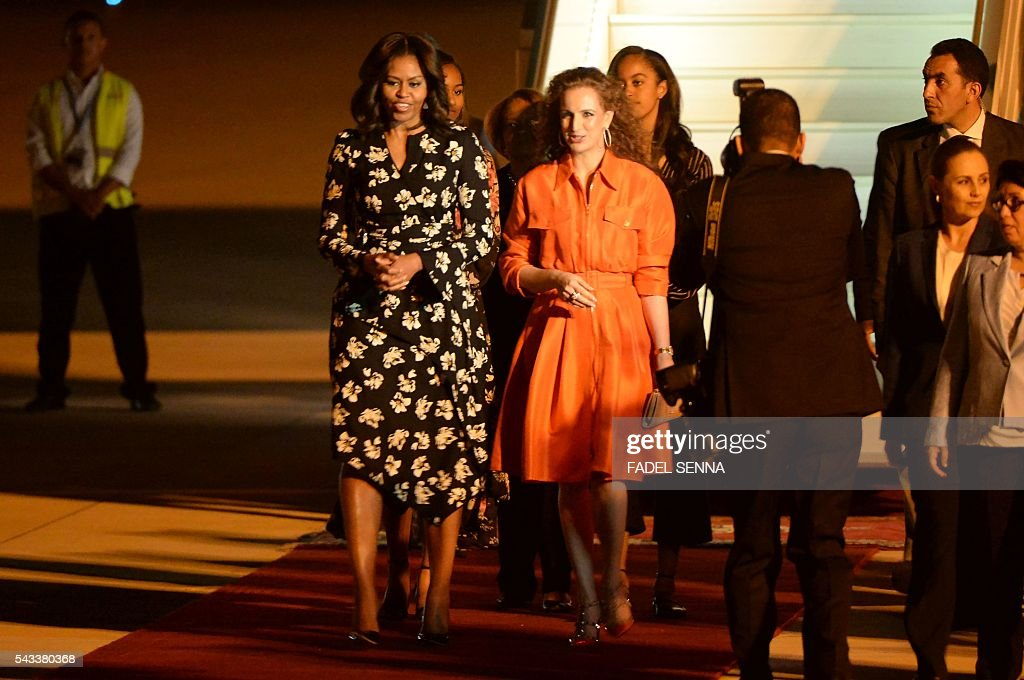 US first lady Michelle Obama is welcomed by the Moroccan Princess Lalla Salma at the Marrakech International Airport, on June 28, 2016. / AFP / FADEL