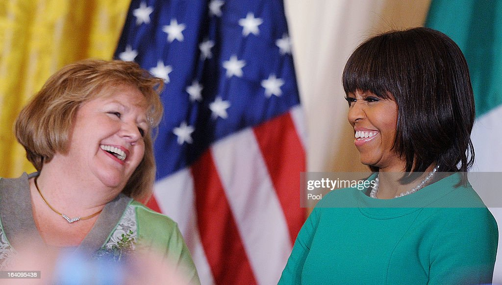 First lady <a gi-track='captionPersonalityLinkClicked' href=/galleries/search?phrase=Michelle+Obama&family=editorial&specificpeople=2528864 ng-click='$event.stopPropagation()'>Michelle Obama</a> (R) jokes with Irish Prime Minister Enda Kenny's wife, Fionnuala, during a reception in the East Room on March 19, 2013 in Washington, DC. President Obama met with Irish Prime Minister Enda Kenny prior to the annual St. Patrick's Day lunch hosted at the Capitol.