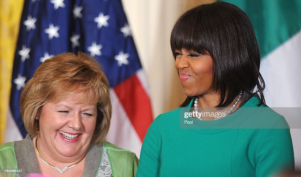 First lady Michelle Obama (R) jokes with Irish Prime Minister Enda Kenny's wife, Fionnuala, during a reception in the East Room on March 19, 2013 in Washington, DC. President Obama met with Irish Prime Minister Enda Kenny prior to the annual St. Patrick's Day lunch hosted at the Capitol.