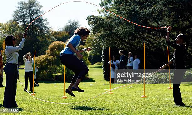 S first lady Michelle Obama jump ropes 'Double Dutch' on the South Lawn of the White House during an event promoting exercise and healthy eating for...