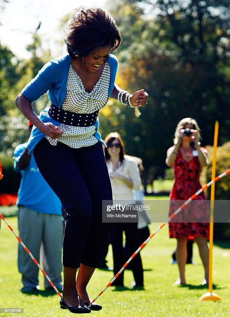 U.S. first lady <a gi-track='captionPersonalityLinkClicked' href=/galleries/search?phrase=Michelle+Obama&family=editorial&specificpeople=2528864 ng-click='$event.stopPropagation()'>Michelle Obama</a> jumps rope on the South Lawn of the White House during an event promoting exercise and healthy eating for children October 21, 2009 in Washington, DC. The Healthy Kids Fair included events on cooking healthy meals and emphasized children getting a proper amount of outdoor exercise each day.
