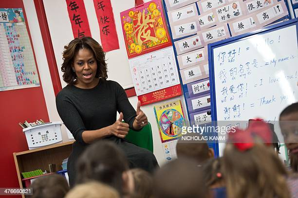 US First Lady Michelle Obama learns some basic Mandarin at Washington Yu Ying Public Charter School a Chineseimmersion International Baccalaureate...