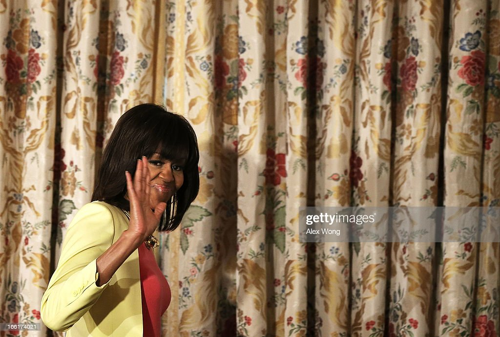 U.S. first lady <a gi-track='captionPersonalityLinkClicked' href=/galleries/search?phrase=Michelle+Obama&family=editorial&specificpeople=2528864 ng-click='$event.stopPropagation()'>Michelle Obama</a> leaves after she made remarks during an interactive student workshop at the State Dining Room of the White House April 9, 2013 in Washington, DC. The first lady hosted middle and high school students from across the country to take part in the workshop on 'Soulsville,