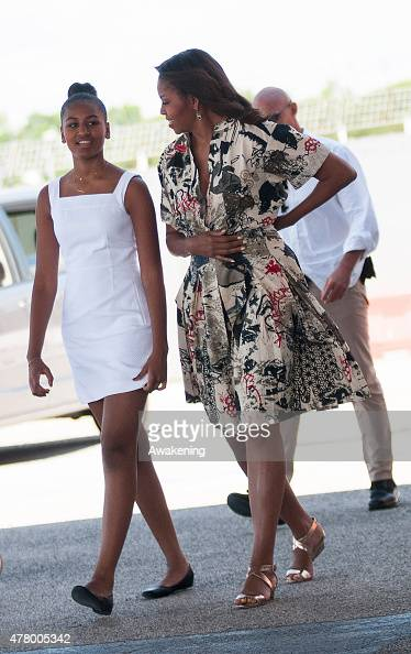 First Lady Michelle Obama leaves with daughters Malia Obama and Sasha Obama on June 21 2015 in Venice Italy Michelle Obama has travelled to Italy...