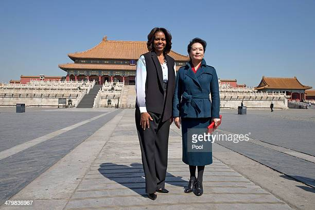 S first lady Michelle Obama left and Peng Liyuan wife of Chinese President Xi Jinping pose for photograph as they visit to Forbidden City March 21...