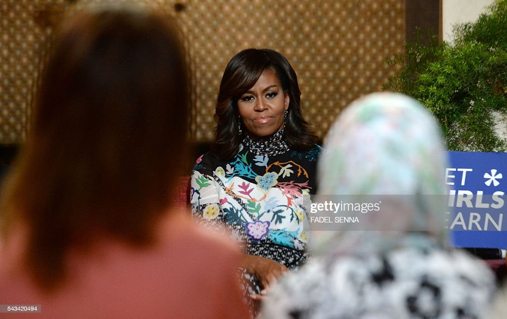 US first lady Michelle Obama listens as she meets with Moroccan young women following the 'Let Girls Learn' Program on June 28, 2016 in the Western Moroccan city of Marrakesh. US First Lady Michelle Obama began a two day visit to Morocco to participate in a CNN-moderated conversation with adolescent girls on the challenges they face in getting a quality education. / AFP / FADEL