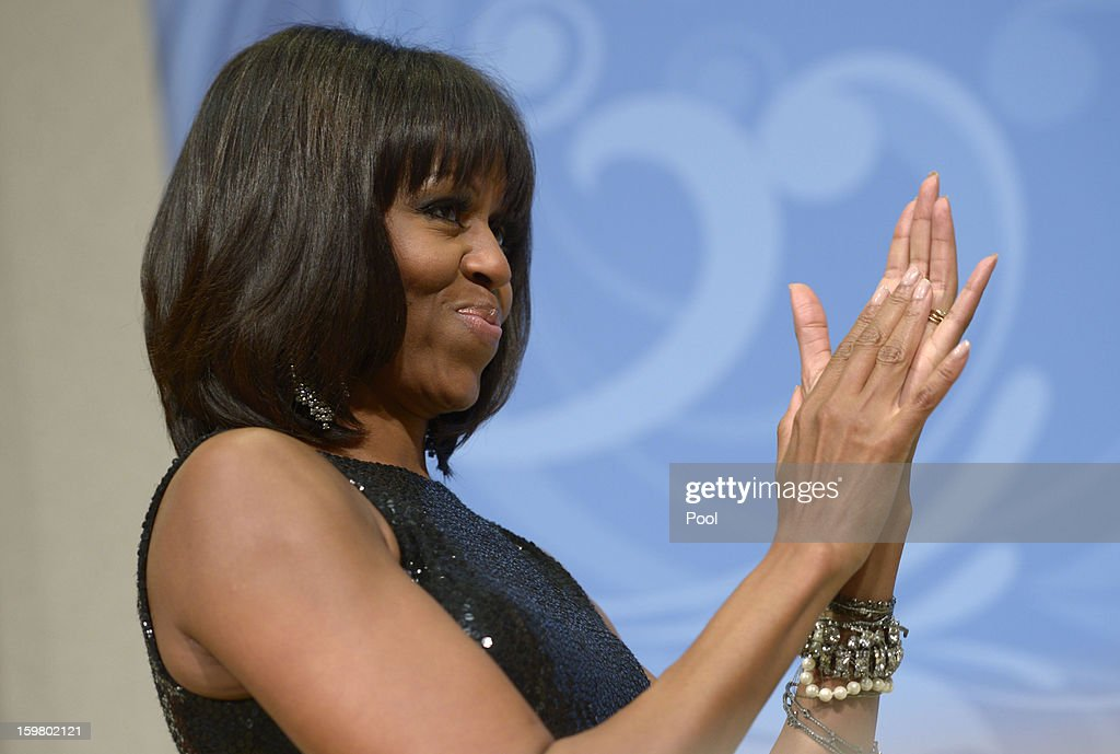First Lady <a gi-track='captionPersonalityLinkClicked' href=/galleries/search?phrase=Michelle+Obama&family=editorial&specificpeople=2528864 ng-click='$event.stopPropagation()'>Michelle Obama</a> listens as U.S. President Barack Obama delivers remarks at the Inaugural Reception at the National Building Museum on January 20, 2013 in Washington, D.C. Obama defeated Republican candidate Mitt Romney on Election Day 06 November 2012 to be re-elected for a second term.
