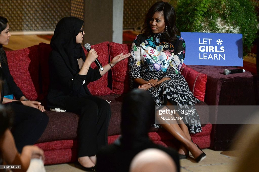 US first lady Michelle Obama (R) listens to a Moroccan young woman following the 'Let Girls Learn' Program on June 28, 2016 in the Western Moroccan city of Marrakesh. US First Lady Michelle Obama began a two day visit to Morocco to participate in a CNN-moderated conversation with adolescent girls on the challenges they face in getting a quality education. / AFP / FADEL