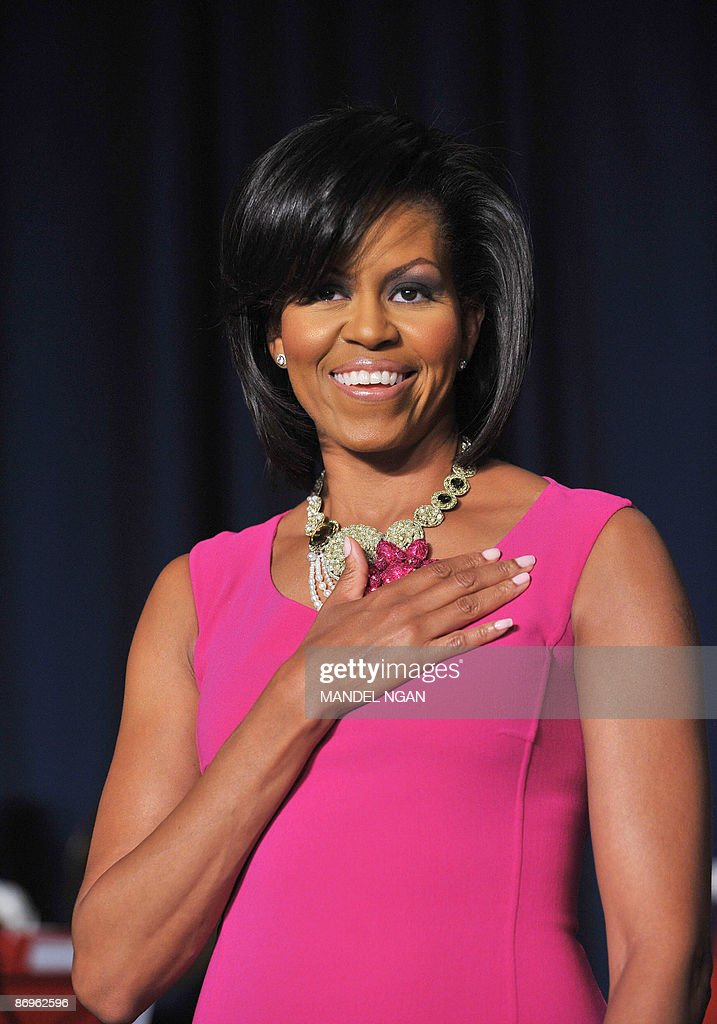 US First Lady <a gi-track='captionPersonalityLinkClicked' href=/galleries/search?phrase=Michelle+Obama&family=editorial&specificpeople=2528864 ng-click='$event.stopPropagation()'>Michelle Obama</a> listens to the national anthen at the White House Correspondents� Association annual dinner on May 9, 2009 at the Washington Hilton hotel in Washington. AFP PHOTO/Mandel NGAN