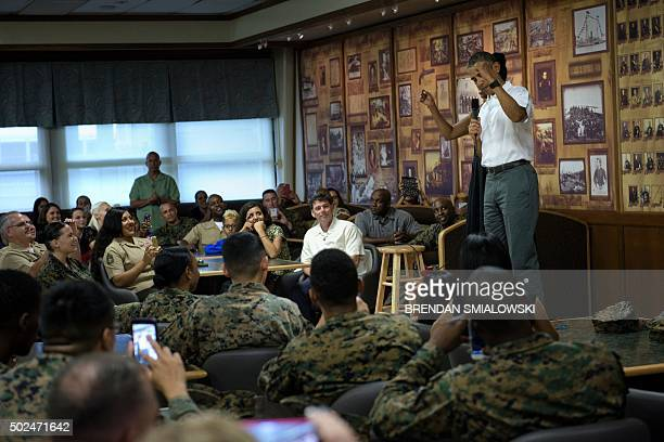 US first lady Michelle Obama listens while US President Barack Obama speaks to members of the US Marines their loved ones and others to celebrate the...