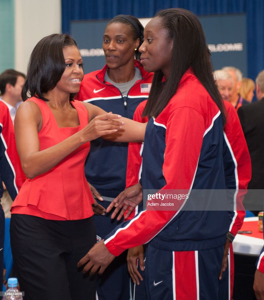 First Lady <a gi-track='captionPersonalityLinkClicked' href=/galleries/search?phrase=Michelle+Obama&family=editorial&specificpeople=2528864 ng-click='$event.stopPropagation()'>Michelle Obama</a> meets <a gi-track='captionPersonalityLinkClicked' href=/galleries/search?phrase=Sylvia+Fowles&family=editorial&specificpeople=707903 ng-click='$event.stopPropagation()'>Sylvia Fowles</a> and <a gi-track='captionPersonalityLinkClicked' href=/galleries/search?phrase=Tina+Charles+-+Basketball+Player&family=editorial&specificpeople=7137931 ng-click='$event.stopPropagation()'>Tina Charles</a> (R) of the 2012 Team USA at the University of East London on July 27, 2012 in London, England. <a gi-track='captionPersonalityLinkClicked' href=/galleries/search?phrase=Michelle+Obama&family=editorial&specificpeople=2528864 ng-click='$event.stopPropagation()'>Michelle Obama</a> addressed members of the 2012 Team USA as leader of the US Olympics delegation, ahead of opening ceremony for the Olympics.