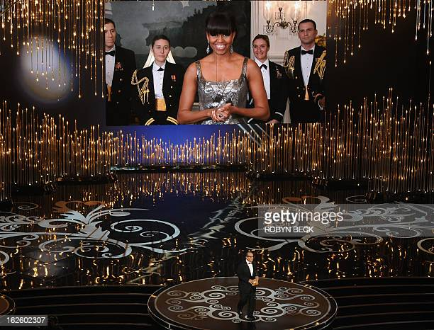 US First Lady Michelle Obama on a video screen announces the Oscar for Best Movie along with actor Jack Nicholson onstage at the 85th Annual Academy...