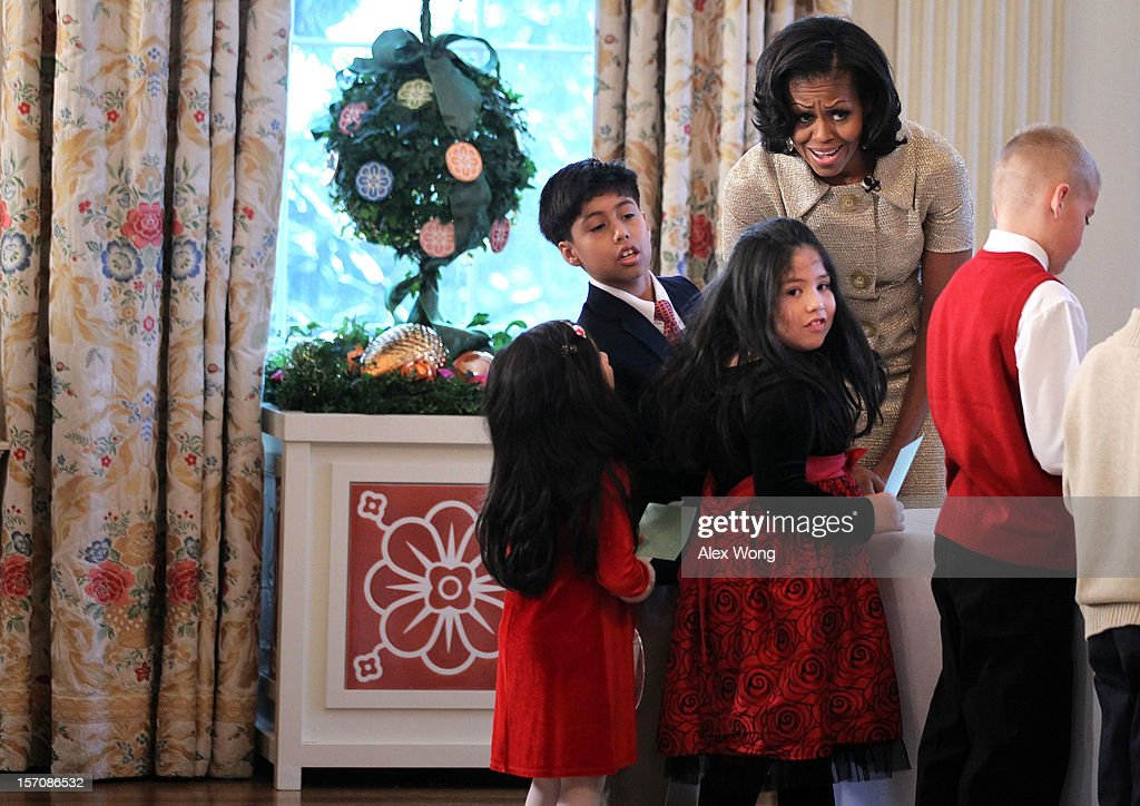 U.S. first lady <a gi-track='captionPersonalityLinkClicked' href=/galleries/search?phrase=Michelle+Obama&family=editorial&specificpeople=2528864 ng-click='$event.stopPropagation()'>Michelle Obama</a> participates in craft activities with military children at the State Dining Room after a preview of the 2012 White House holiday decorations November 28, 2012 at the White House in Washington, DC. The first lady welcomed military families, including Gold Star and Blue Star parents, spouses and children, to the White House for the first viewing of the 2012 holiday decorations.