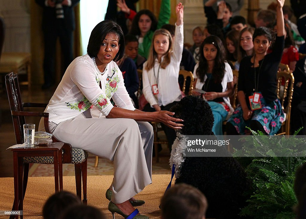 U.S. first lady <a gi-track='captionPersonalityLinkClicked' href=/galleries/search?phrase=Michelle+Obama&family=editorial&specificpeople=2528864 ng-click='$event.stopPropagation()'>Michelle Obama</a> pets the family dog Bo as she speaks to children in the East Room of the White House April 22, 2010 in Washington, DC. Mrs. Obama addressed and answered questions from children of Executive Office employees at the White House's annual Take Our Daughters and Sons to Work Day.