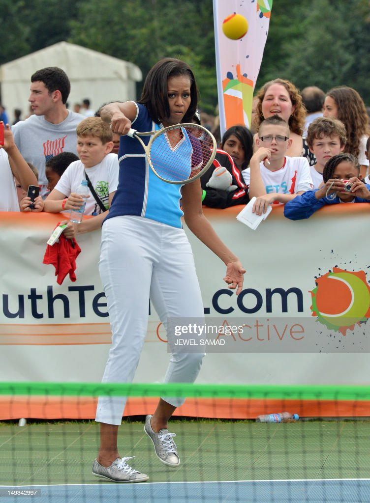 US First Lady Michelle Obama plays tennis during 'Let's Move-London' event at the Winfield House in London on July 27, 2012, hours before the start of the London 2012 Olympic Games. AFP PHOTO/ JEWEL SAMAD