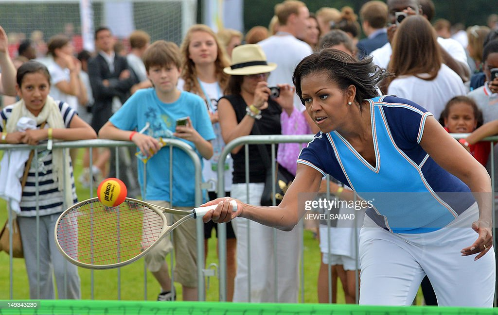 US First Lady Michelle Obama plays tennis with children as part of her 'Let's Move-London' event at the Winfield House in London on July 27, 2012, hours before the official start of the London 2012 Olympic Games.