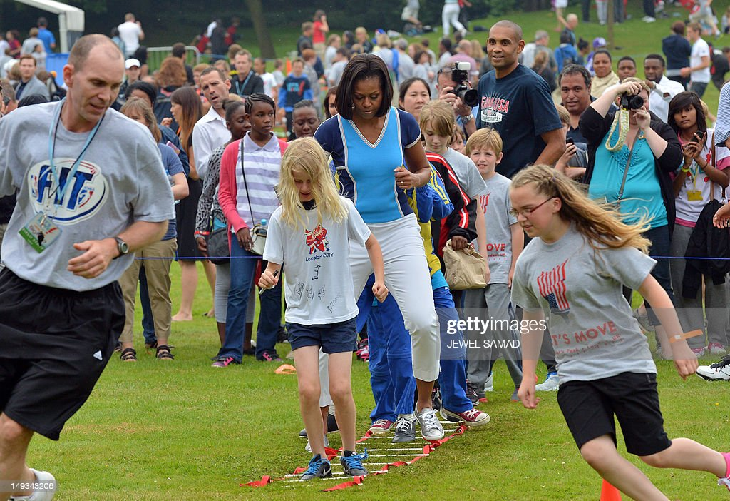 US First Lady Michelle Obama plays with children during 'Let's Move-London' event at the Winfield House in London on July 27, 2012, hours before the official start of the London 2012 Olympic Games. AFP PHOTO/ JEWEL SAMAD