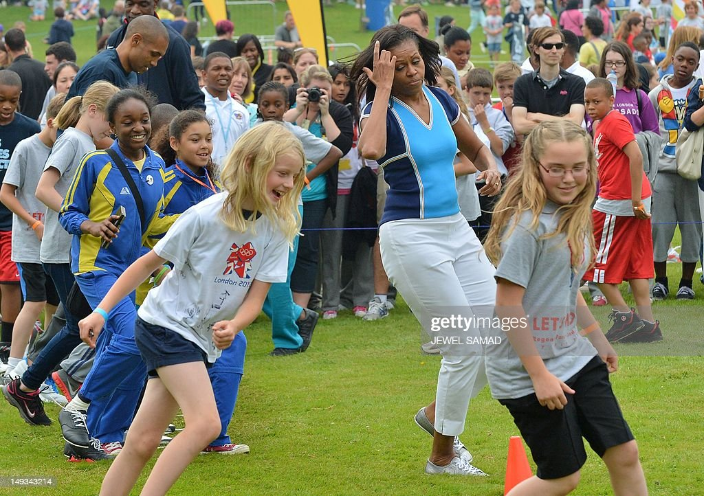 US First Lady Michelle Obama plays with children during the 'Let's Move-London' event at the Winfield House in London on July 27, 2012, hours before the official start of the London 2012 Olympic Games.