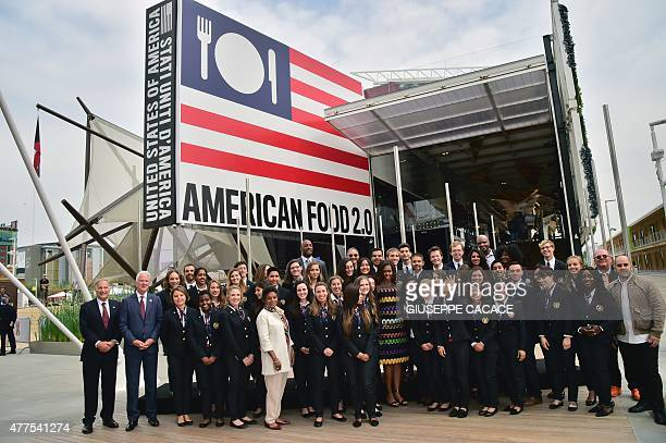 US First Lady Michelle Obama poses for a family picture with workers of the United States pavilion at the Expo in Milan on June 18 2015 AFP PHOTO /...