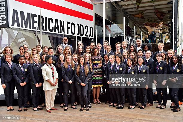 US First Lady Michelle Obama poses for a family pictures with workers of the US pavillion at the World Expo in Milan on June 18 2015 US First Lady...