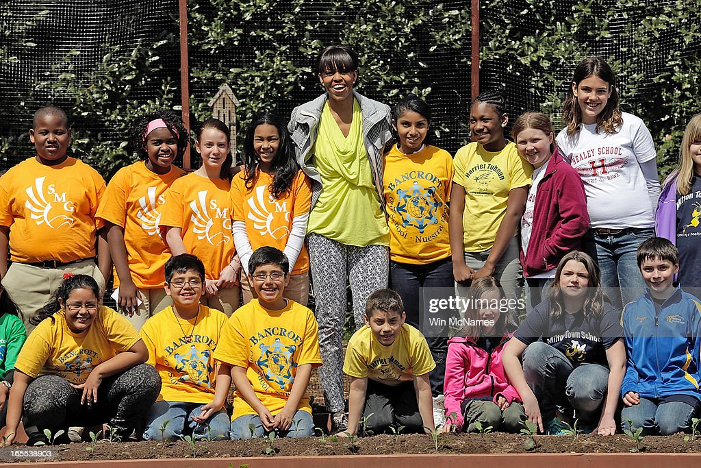 U.S. first lady Michelle Obama poses for a photograph with schoolchildren after planting the White House Kitchen Garden on the South Lawn of the White House April 4, 2013 in Washington, DC. For the fifth time, the first lady invited students from 'schools that have made exceptional improvements to school lunches' from Florida, Massachusetts, Tennessee and Vermont to help her plant the garden.
