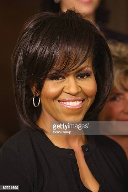S First Lady Michelle Obama poses with other first ladies at the spouses' evening at the opening of the NATO summit on April 3 2009 in Baden Baden...
